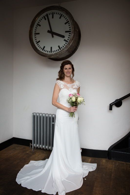 Bride beside the clock in Hotel du vin in Henley