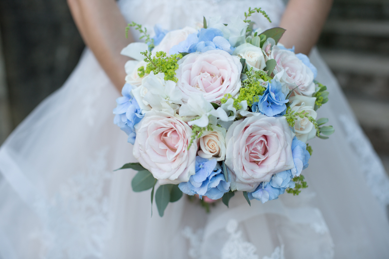 Bride with her bouquet at Tylney Hall