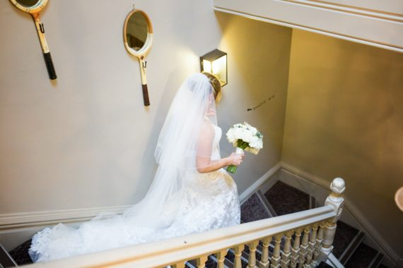Bride in the beautiful stairs at Olde Bell Hotel in Hurley