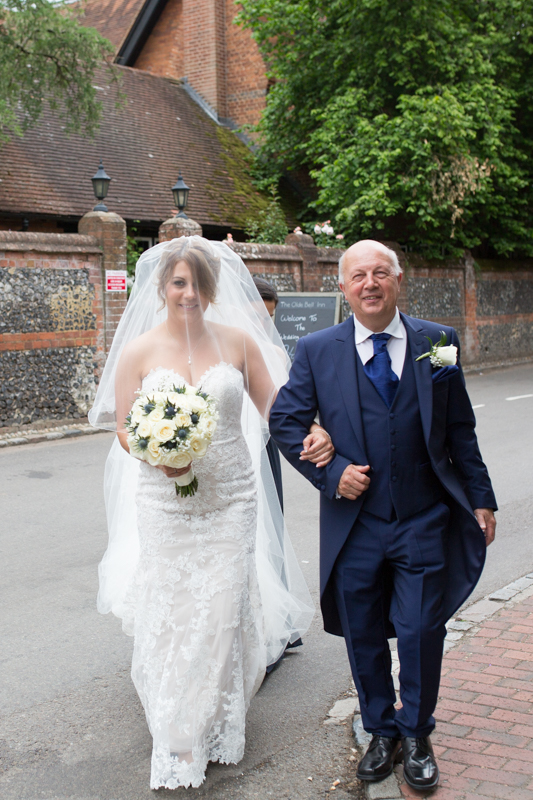 Bride and her father walking to the ceremony at Olde Bell in Hurley