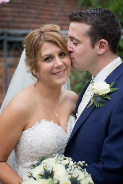 Bride and Groom in the garden at Olde Bell in Hurley