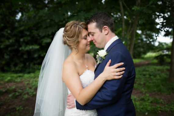 Couple looking happy at their wedding at Olde Bell Hotel in Hurley