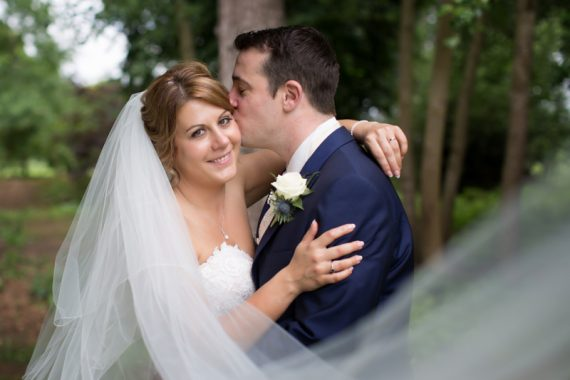 Couple looking happy at their wedding in Olde Bell Hotel Berkshire