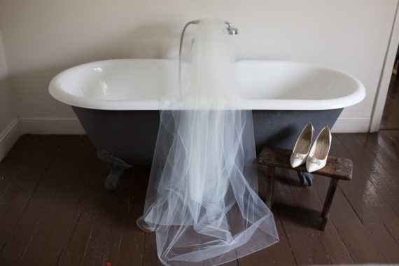 Shoes and veil at wedding at Olde Bell Hotel in Hurley