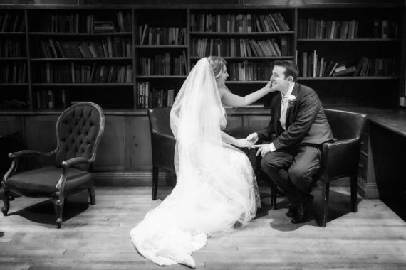 Bride and Groom in the Library at their wedding in Olde Bell Hotel in Hurley Berkshire