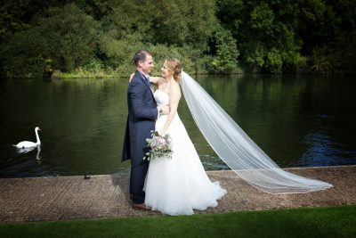 Bride and Groom portrait by the river at Oakley Court Hotel