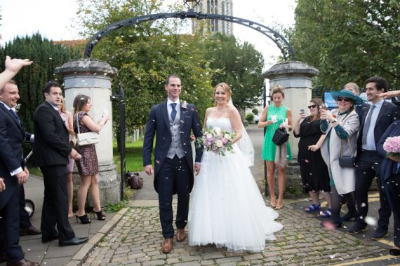 Bride and Groom outside All saints church in Marlow