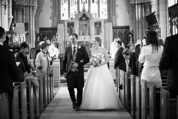 Bride and Groom walking up the aisle at All Saints Church in Marlow