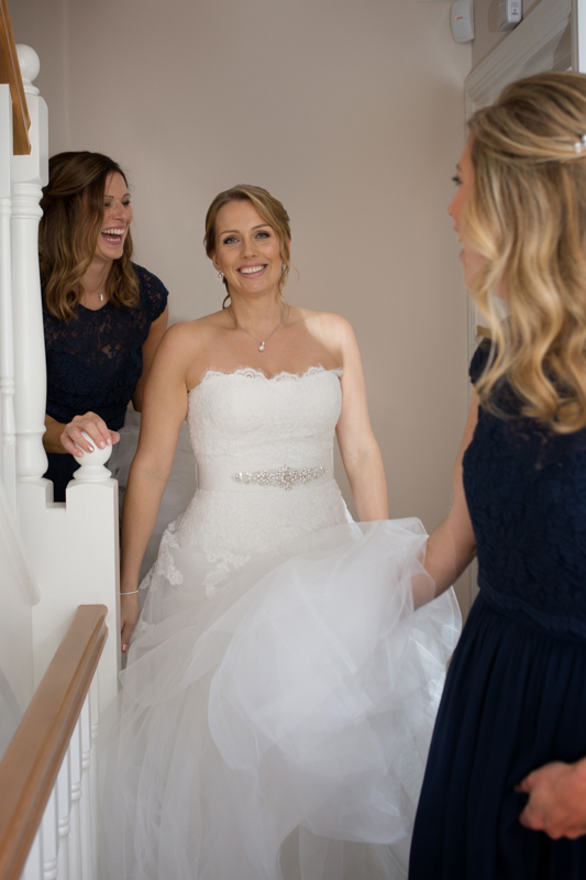 Bride with her bridesmaids looking happy