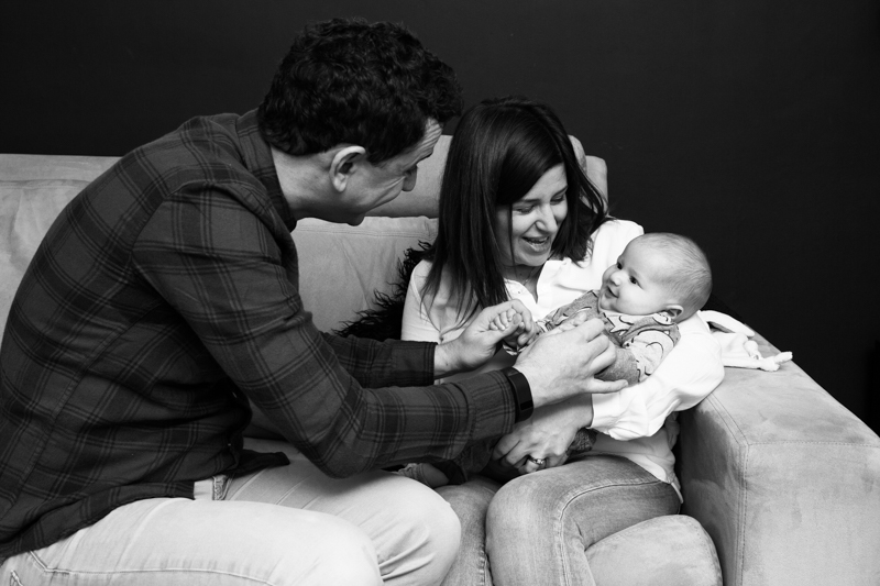 Couple with their smiling baby