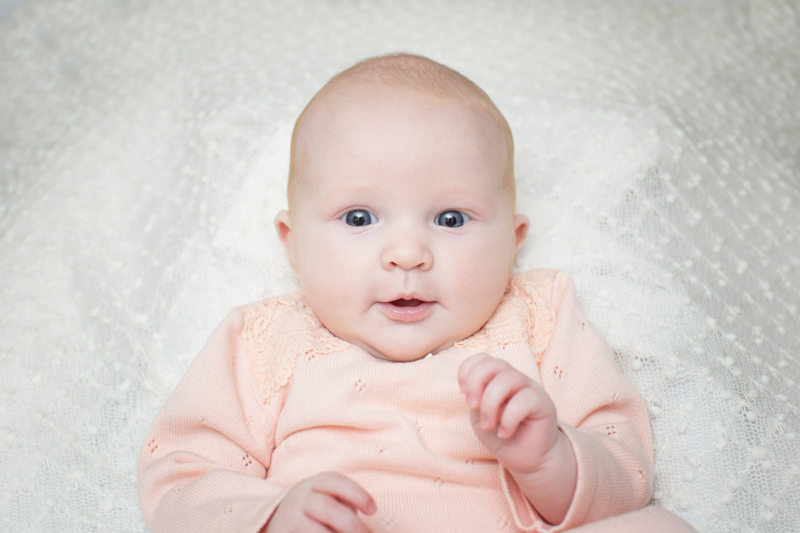Smiling baby in a family photo shoot in Henley