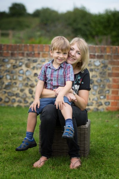 Young boy sitting on Mum's knee in family photo shoot near Henley