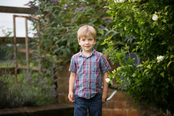 Fun, informal portrait of young boy near Henley