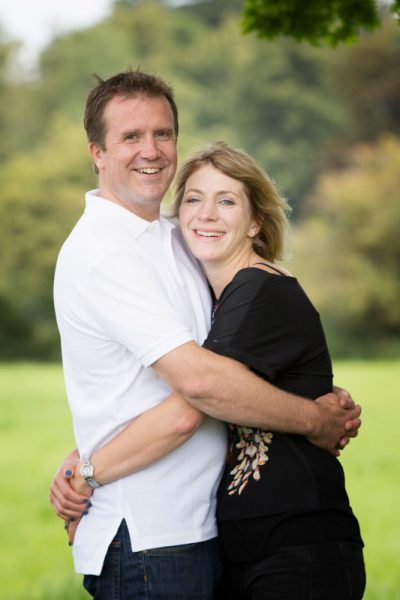Couple in happy shot during family photo shoot in Henley on Thames