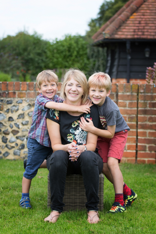 Mum and her children having fun during family photo shoot in Henley