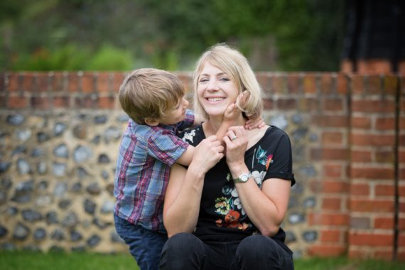 Boy with his mum in fun portrait in Henley
