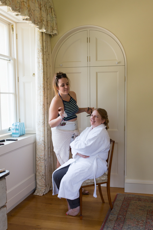 Bride getting prepared for her wedding at Rockley Manor