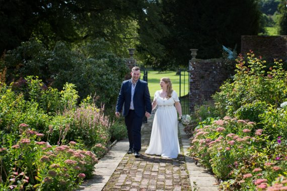 Bride walking with her son to her wedding at Rockley Manor
