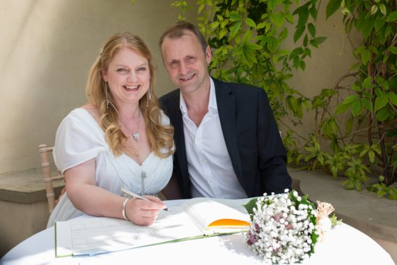 Couple smiling after they have signed wedding register at Rockley Manor