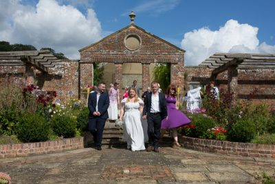 Bride and Groom with their guests at Rockley Manor wedding
