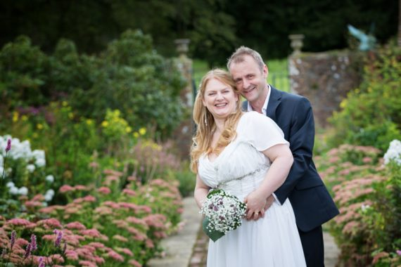 Couple smiling in the gardens at Rockley Manor wedding venue