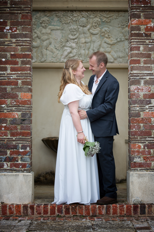 Natural smiles from a bride and groom at their Rockley Manor wedding