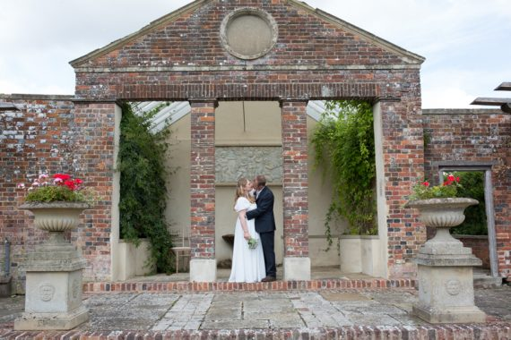 Couple in romantic shot in the grounds of Rockley Manor in Wiltshire