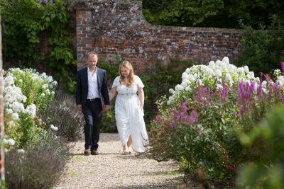 Couple walking hand in hand at Rockley Manor wedding