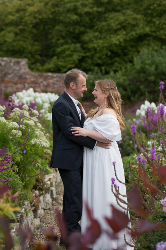 Couple in the gardens at Rockley Manor wedding venue