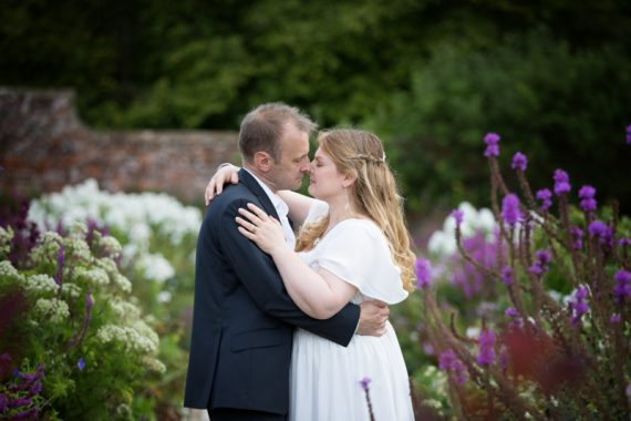 Bride and Groom in romantic pose in garden of Rockley Manor