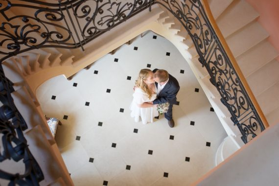 Couple kissing in the stairwell at Rockley Manor