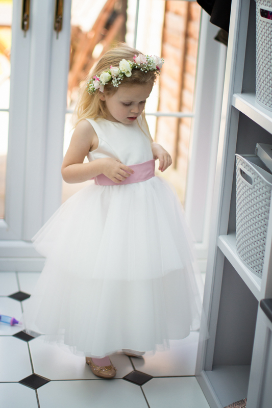 Cute flower girl excited for the wedding