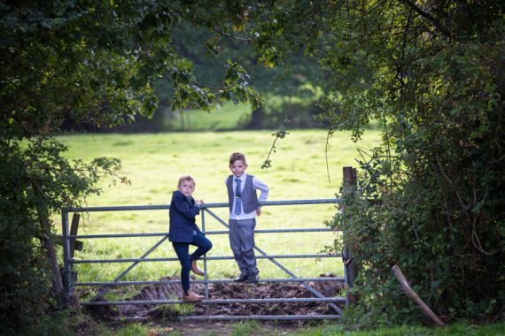 Two boys looking cheeky at a wedding at The Cricketers in Warfield, Berkshire