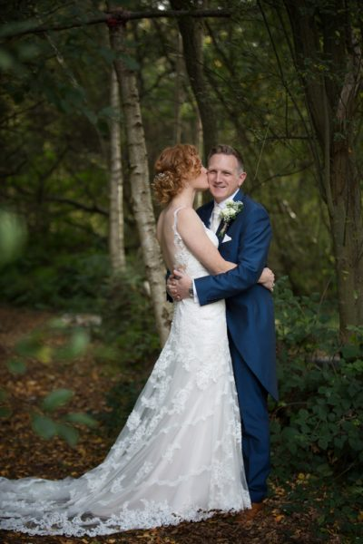 Bride and Groom in woodland near The Cricketers at Warfield, Berkshire