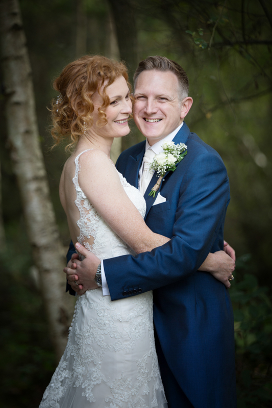 Bride and Groom looking happy at their wedding at The Cricketers in Warfield