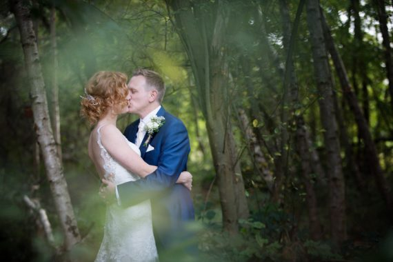 Bridal portrait in woodland near The Cricketers in Warfield, Berkshire