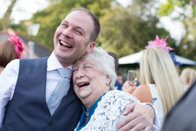 guests laughing at wedding at The Cricketers in Warfield, Berkshire