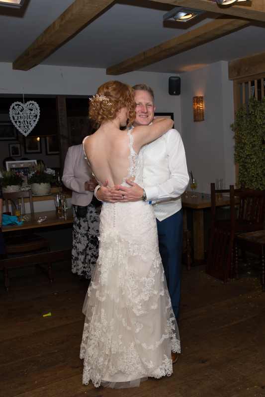 Bride and Groom dancing at their wedding at The Cricketers in Warfield Berkshire