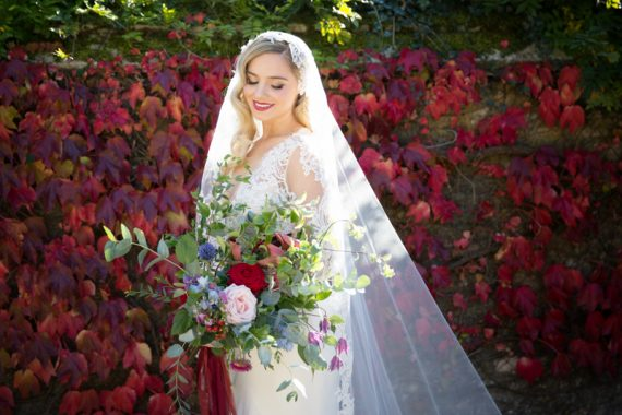 Bride looking at her vintage bridal bouquet