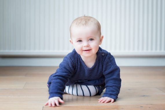 Young baby smiling at the camera in Henley photo shoot