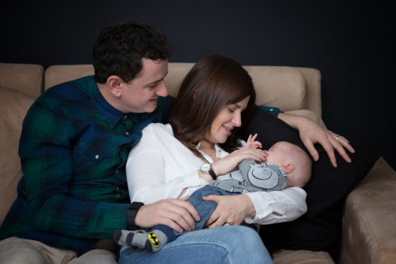 Loving moment with parents and their child in family photo shoot in Henley