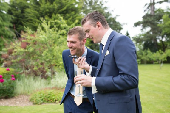 Wedding guests laughing at Olde Bell Hurley
