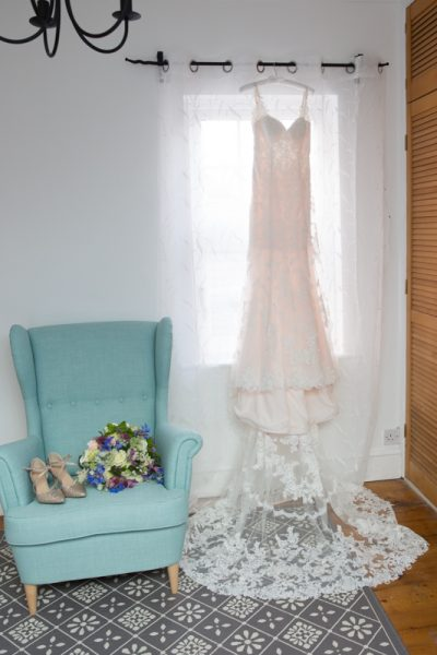 Wedding Dress, bouquet and shoes displayed in bride's home