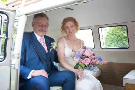 Bride and her father in vintage camper van