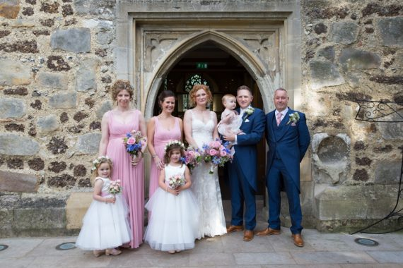 Wedding group shot outside St Michael's Church in Warfield, Berkshire