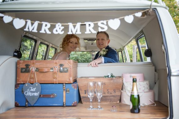 Bride and Groom in Vintage caravan at The Cricketers in Warfield in Berkshire
