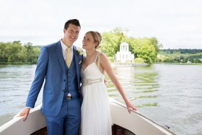 Couple on a boat in front of Temple Island in Henley