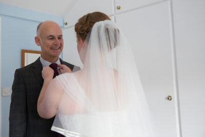 Bride fixing her father's tie at Crown Inn Pishill wedding