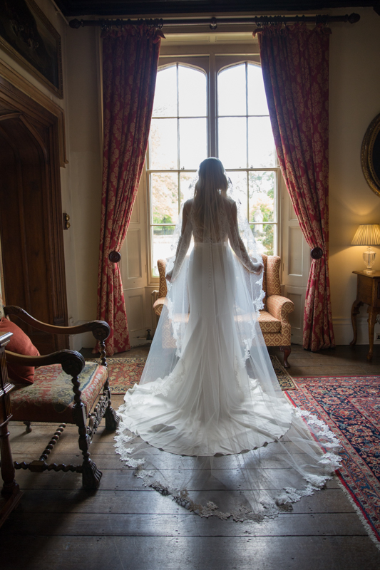 Back view of beautiful bride at Manor House Hotel in Oxfordshire