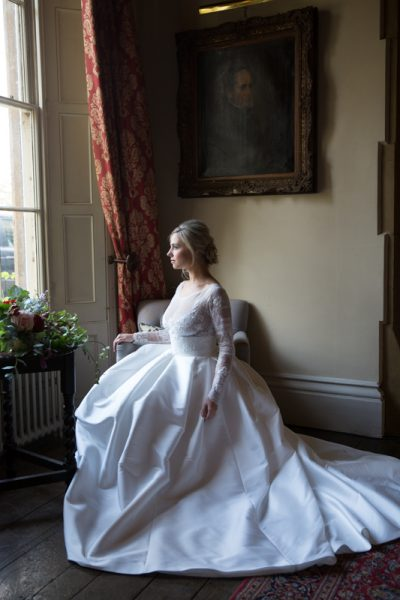 Bride looking out of window at Weston Manor Country House